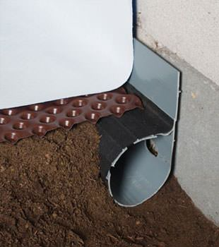 Closeup of a crawl space drainage system installed in Seneca Falls