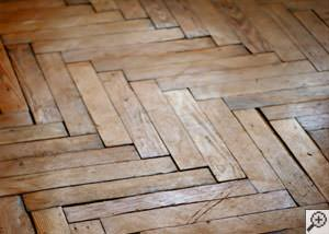 A  buckling wood floor.