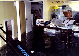 A laundry room flood in , with several feet of water flooded in.