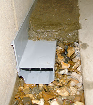 A basement drain system installed in a Fairport home